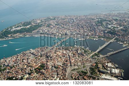 Aerial view looking south across Istanbul across the Golden Horn waterway towards the old city and the Marmara Sea beyond. Crossing the Golden Horn are the Galata Ataturk and Halic bridges.