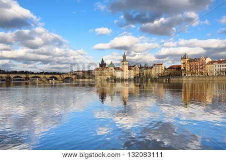 clouds are reflected in the river Vltava, Prague