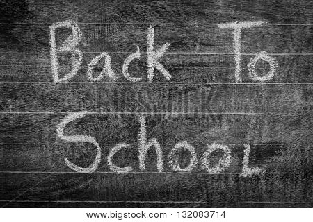 Freehand drawing Back to school on chalkboard ,Filtered image processed black and white effect.