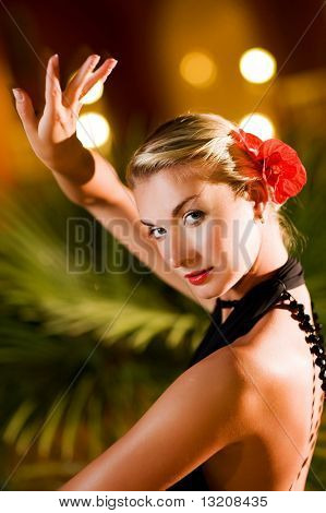 Beautiful young woman dancing tango