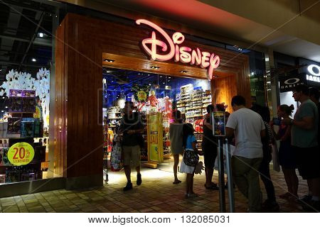 HONOLULU HI - NOVEMBER 27: People wait in line for opening of Disney Store for special 20% off storewide on Grey Thursday evening at the Ala Moana shopping center. taken on November 27 2014 at Ala Moana Shopping center in Honolulu Hawaii.