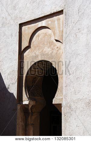 MALAGA, SPAIN - JULY 11, 2008 - Ornate arch within the Nasrid Palace Malaga Castle (Alcazaba de Malaga) Malaga Malaga Province Andalucia Spain Western Europe, July 11, 2008.
