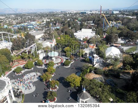 SANTA CLARA - AUGUST 7: Aerial view of Great America theme park featuring rides like roller coasters and a variety of shops on August 7 2010 Great America Park Santa Clara California.