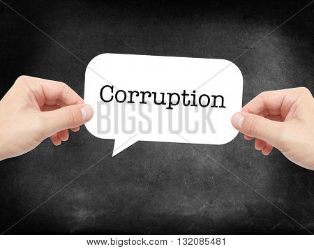 Corruption written on a speechbubble
