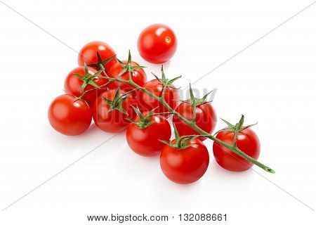 Cherry tomatoes. Ripe fresh cherry tomatoes on branch isolated on white background