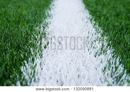 White Line Marks Painted On Artificial Green Turf Background. Playground With Plastic Grass.