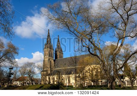 Medieval church cloudless day in Prague, view from the park