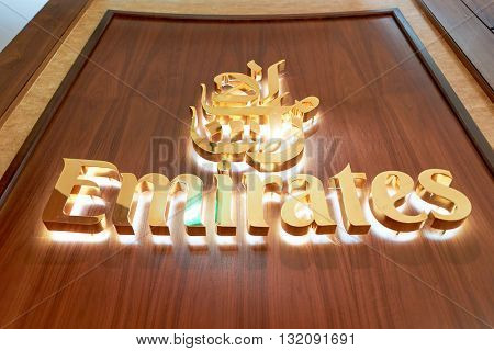 DUBAI, UAE - CIRCA APRIL, 2016: close up shot of Emirates Logo at Dubai International Airport. Dubai International Airport is the primary airport serving Dubai, United Arab Emirates