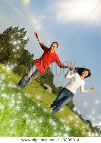Young couple running on a meadow