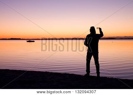 Man On Beach Photograph Romantic Morning At Sea. Fantastic Morning With Smooth Water Level