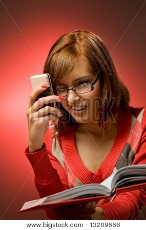 Funny redhead woman searching a phone number in telephone directory