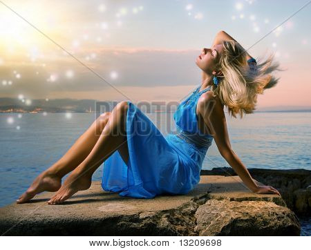 Sexy young woman relaxing near the ocean