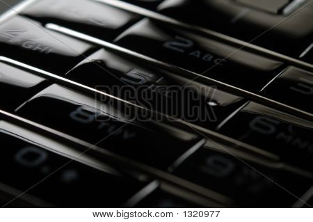 Close Up Shot Of Mobile Keypad Under Dark