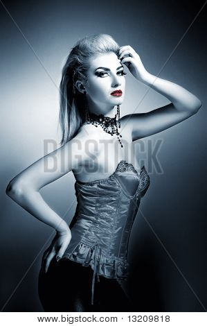 Sexy gothic woman with creative hairstyle