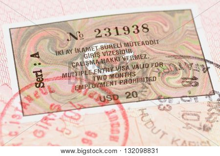 Passport page with Turkey visa and immigration control stamp.