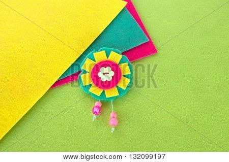 Flower felt brooch with beads. Bright children's jewelry. A simple idea accessories