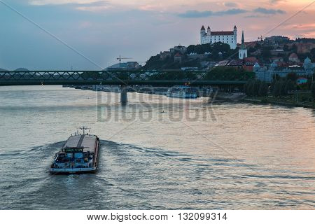 Bratislava, Slovakia - May 29, 2016 River Danube crossing the city Bratislava in the light of the sunset. View on the old city with the historical cathedral and the castle on the the hill.