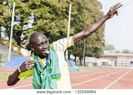 african american sprinter athlete celebrates his victory