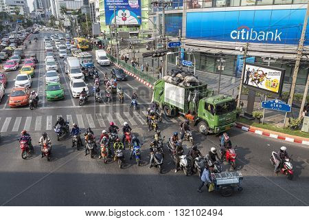 BANGKOK THAILAND - APR 29 : traffic stop for red light signal at Asoke junction on april 29 2016 thailand. traffic jam is one of worse issue of Bangkok