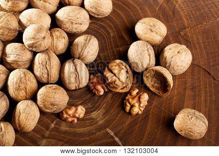 Walnuts scattered on the stump photo studio