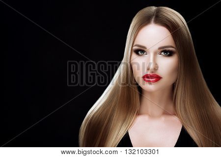 Beauty model girl with healthy blond streaked hair. Beautiful blonde woman with bright makeup, shiny straight hair. Hair. Hair products, hair care. Hair care, capacity. Isolated on black