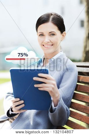 business, technology, cloud computing and people concept - young smiling woman with tablet pc computer and internet icon transferring data sitting on bench in city
