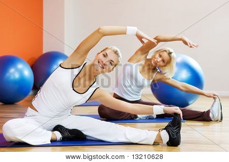 Group of people doing stretching exercise