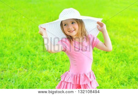 Happy Smiling Little Girl In Dress And Straw Hat Outdoors Summer