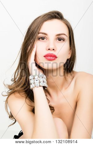close-up of sexy elegant fashionable woman with jewelry bracelet.