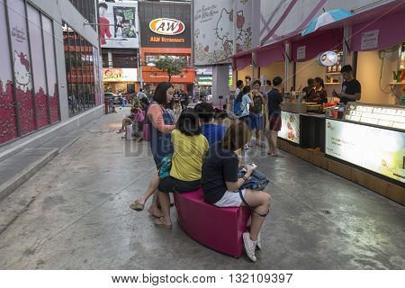BANGKOK THAILAND - APR 30 : people in alley side of Digital Gateway in siam square on april 30 2016 thailand. siam square is famous shopping place of Bangkok