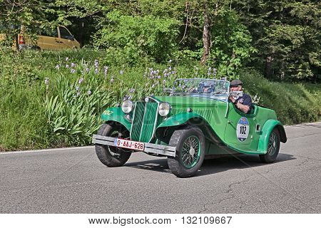 PASSO DELLA FUTA (FI) ITALY - MAY 21: driver and co-driver on a vintage Lancia Augusta Cabriolet (1934) in classic car race Mille Miglia on May 21, 2016 in Passo della Futa (FI) Italy