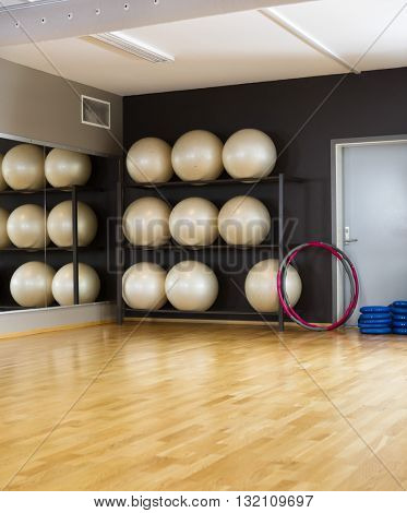 Hoops And Exercise Balls In Health Club