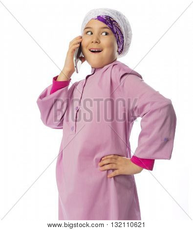 Little muslim girl with mobile phone isolated