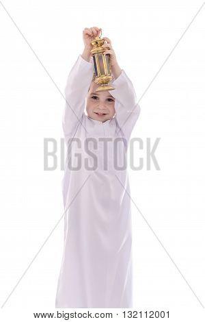 Happy Young Muslim Boy With Ramadan Lantern
