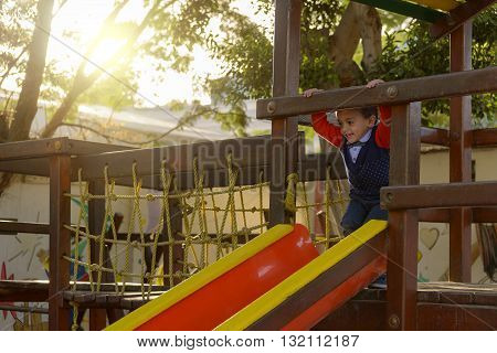 Little Young Boy Playing At Park