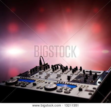 Dj mixer over abstract background