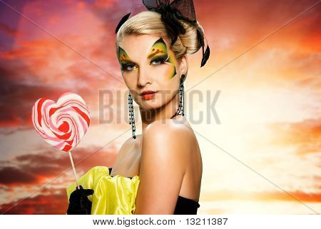 Beautiful young woman with candy