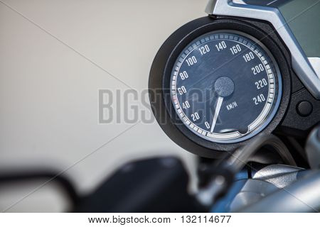Color detail with the speedometer of a motorcycle.
