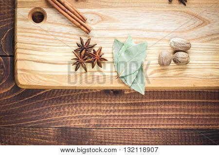 Beautiful Colorful Spices On Bright Kitchen Board On Old Wooden Brown Table. Free Space For Your Tex