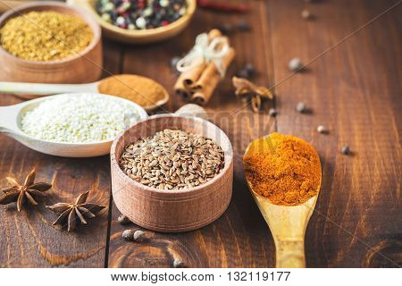 Beautiful Colorful Spices In Wooden Spoons On An Old Wooden Brown Table. Free Space For Your Text