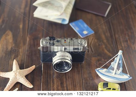 Car Figurine, Passport, Credit Card, Camera, Map, Ship And Starfish For Use As Trip Vacation Concept