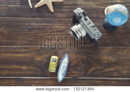 Ship And Car Figurine, Camera And Starfish For Use As Trip Vacation Concept (vintage Tone And Select
