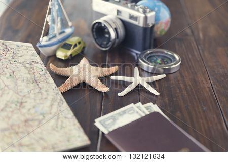 Banknote, Compass, Passport, Globe, Camera, Map, Ship Car And Starfish Figurine For Use As Trip Vaca
