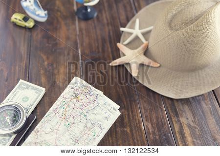Map, Hat, Compass, Passport, Banknote, Globe,  Ship Car And Starfish Figurine For Use As Trip Vacati