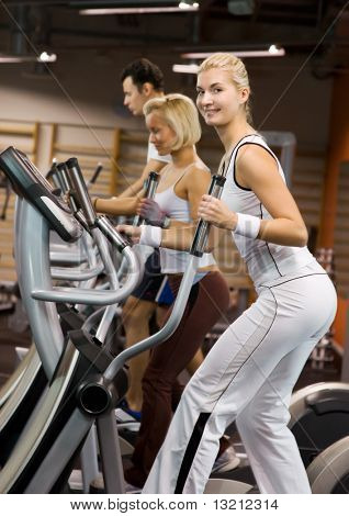 Group of people jogging in a gym