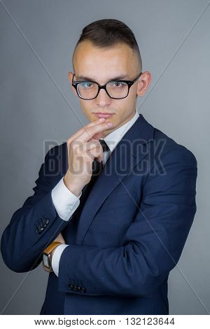 Thoughtful Young Guy In Glasses