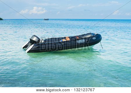 Black inflatable boat with sea in thailand