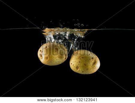 Falling Potato Tubers In Water