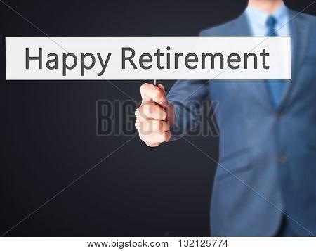 Happy Retirement - Businessman Hand Holding Sign
