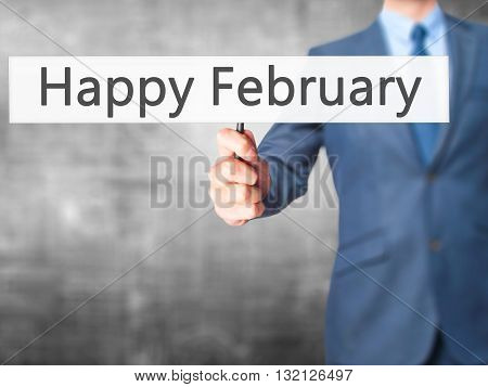 Happy February - Businessman Hand Holding Sign